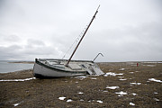 Beached Photos - A Wooden Sailboat Is Beached by Pete Ryan
