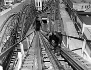 1930s Candid Photos - A Workman Greases Up The Tracks by Everett