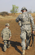 Bonding Metal Prints - A Young Boy Joins His Squad Leader Metal Print by Stocktrek Images
