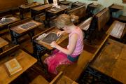 Desk Posters - A Young Girl Draws On A Chalkboard Poster by Joel Sartore