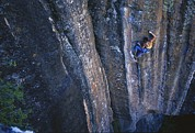 Sporting Equipment Prints - A Young Woman Climbs A Wall In Moab Print by Jimmy Chin