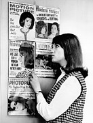 First Lady And President Prints - A Young Women Observes A Display Print by Everett