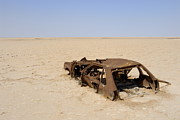 Wreck Prints - Abandoned and rusty car wreck in desert Print by Sami Sarkis
