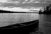 Blackwhite Posters - Abandoned Canoe Floating On Water Poster by Keith Levit