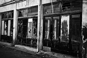 Shopfronts Framed Prints - abandoned greek cypriot shopfronts next to restricted area of the UN buffer zone in green line Framed Print by Joe Fox