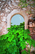 Abandonment Framed Prints - Abandoned old house with an arched door Framed Print by Manolis Tsantakis