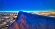 Liquid Droplets Prints - Above the Clouds on a 757 Print by David Patterson