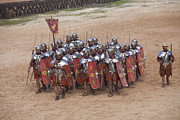 Ruins Photo Prints - Actors Re-enact A Roman Legionaries Print by Taylor S. Kennedy