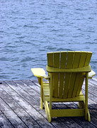 Chair Photo Framed Prints - Adirondack Chair on Dock Framed Print by Olivier Le Queinec