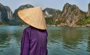 Sun Hat Posters - Admiring Ha Long Bay Poster by Bill Bachmann - Printscapes