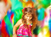Enjoying Prints - Adorable small girl dancing over blur colors background Print by Anna Omelchenko