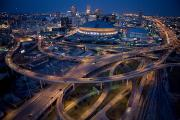 Roads Posters - Aerial Of The Superdome In The Downtown Poster by Tyrone Turner