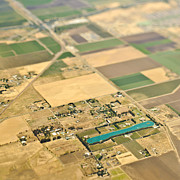 Field Of Crops Prints - Aerial View of a Lake in an Agricultural Community Print by Eddy Joaquim