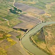 Field Of Crops Prints - Aerial View of a River Passing Through Farmland Print by Eddy Joaquim