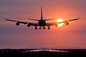 Boeing 747 Photos - Aeroplane Landing At Sunset, Canada by David Nunuk