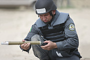 Law Enforcement Prints - Afghan Police Student Prepares Print by Terry Moore