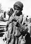 Burkas Prints - Afghan Youngster In A Unicef Feeding Print by Everett