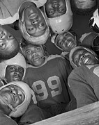 Football Helmets Posters - Africans American Football Huddle Poster by Everett