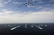 Large Group Of Objects Art - Aircraft Fly Over A Group Of U.s by Stocktrek Images
