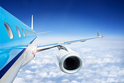 Aircraft Engine Component Prints - Airliner In Flight Above The Clouds Print by Corepics