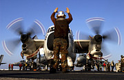 Gesturing Posters - Airmam Instructs The Pilots Of A C-2a Poster by Stocktrek Images
