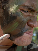 Blending Photo Prints - Airman Applies War Paint To His Face Print by Stocktrek Images