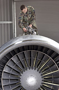 Mechanic Framed Prints - Airman Checks Components Atop A C-5 Framed Print by Stocktrek Images