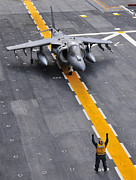 Motioning Posters - Airman Directs An Av-8b Harrier Ii Poster by Stocktrek Images