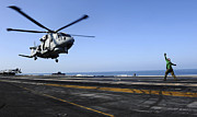 Carrier Posters - Airman Directs An Eh-101 Merlin Poster by Stocktrek Images