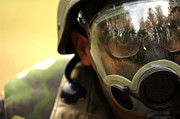 Wearing Glasses Posters - Airman Dons A Gas Mask Poster by Stocktrek Images