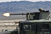 Automatic Posters - Airman Fires A .50 Caliber Heavy Poster by Stocktrek Images