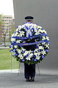 Commemorating Prints - Airman Holds A Wreath During A Ceremony Print by Stocktrek Images