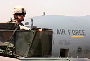 Baghdad Prints - Airman Mans The Turret Atop A Humvee Print by Stocktrek Images