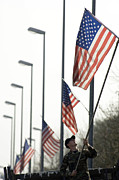 Lightpole Posters - Airman Posts A New Flag On The Main Poster by Stocktrek Images