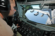 B-52 Framed Prints - Airman Refuels A B-52 Stratofortress Framed Print by Stocktrek Images