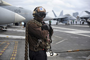 Flight Deck Posters - Airman Stands By With Tie-down Chains Poster by Stocktrek Images