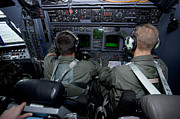 Co-pilot Prints - Airmen At Work In A Mc-130h Combat Print by Gert Kromhout