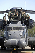 Low Wing Photo Posters - Airmen Conduct Training On The Mh-53 Poster by Stocktrek Images