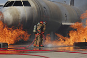 Courage Metal Prints - Airmen Extinguish A Fire On A Training Metal Print by Stocktrek Images