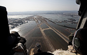 Natural Disasters Art - Airmen Fly Over The Sendai Airport by Stocktrek Images