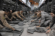 Crouching Prints - Airmen Inspect Their Improved Outer Print by Stocktrek Images