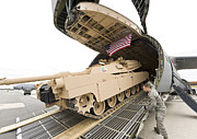 Army Tank Framed Prints - Airmen Load A Tank Into A C-5m Super Framed Print by Stocktrek Images
