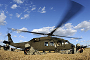 Uh-60 Black Hawk Prints - Airmen Provide Security In Front Print by Stocktrek Images