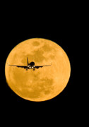 Airplane And Moon Print by David Nunuk