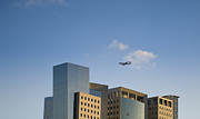 Office Space Photo Framed Prints - Airplane Flying Over Office Buildings Framed Print by Noam Armonn