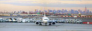 Taxi Posters - Airport Overlook the Big City Poster by Mike McGlothlen