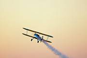 Entertainment Photo Posters - Airshow Smoke Trail At Sunset Poster by Jim McKinley
