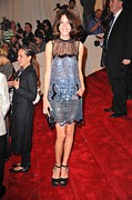 Minidress Framed Prints - Alexa Chung Wearing A Christopher Kane Framed Print by Everett