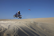 Quad Posters - All Terain Vehicle Jumping At Pismo Beach Dunes Poster by Jason Todd