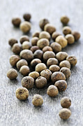 Aromatic Prints - Allspice berries Print by Elena Elisseeva